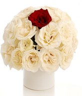 20 White Roses and a Red Rose In A Vase