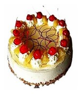 Pineapple cake with cherries on top