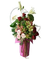 Arrangement of white lilies, red roses, pink roses, cymbidium orchids, and fillers