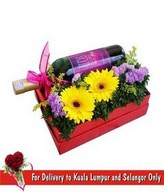 A bottle of Red Wine With Flowers Arrangement in a Special Red Box