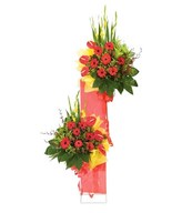 2-tier arrangement with combination of red gerberas and anthurium