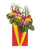 Charming arrangement of red anthuriums, pink lilies & yellow gerberas