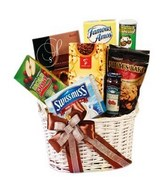 A basket of chocolates, cookies, choco chips & snack