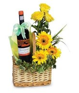 Red Wine & Arrangement of yellow roses and gerberas