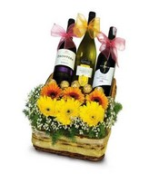 2 Red & 1 White Wine with Ferrero Rocher and Gerberas arrangement