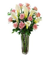 One dozen pink roses with white calla lilies
