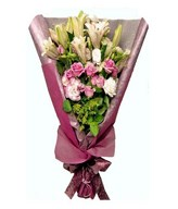 Pink stargazer lilies with pink roses in a bouquet