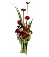 Pink Roses, Pink Carnations, red gerberas, baby Breath and Filler in Ceramic vase