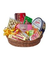 A Chocolate Hamper consist of Butter Cookies, Feerero Rocher and assorted Chocolate in a Basket