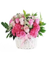 A basket of Assorted Pink Flowers & Baby's Breath