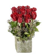 15 Red Roses in a classical glass vase