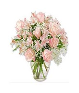 Arrangement of 12 pink roses with fillers in vase