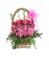 Arrangement of roses and carnation and fillers in a basket