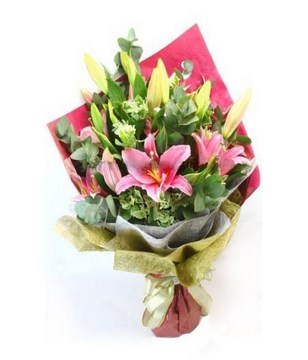 Arrangement of Pink Lily in hand bouquet