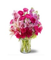 Arrangement of Pink roses, Lilies, Hydrangea and more in vase