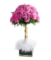 Topiary Flower of pink and purple roses in glass vase