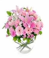 Arrangement of mixed flower in oval glass vase