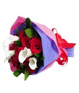 bouquet of red roses and white calla lily