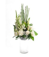 Arrangement of White roses, White Lily and Snap Dragon in Glass vase