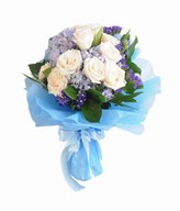 A bouquet of White Roses ), Blue Hydrangea, and fillers.