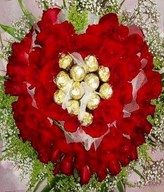 Basket Arrangement of 99 Red Roses with 12 Ferrero Rocher