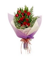 12 red roses with cordyline leaves hand bouquet