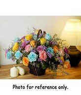 Mixed color roses and caspia in a basket