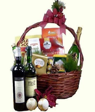 Champagne, 2 bottles of wine with assorted chocolates and titbits in a basket