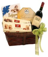 A Basket of Red Wine, 2 boxes of chocolate and 2 boxes of biscuits