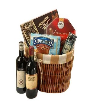 2 bottles of Red Wine, 3 boxes of assorted chocolates & a bottle of jam