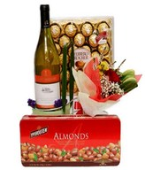 White wine, a box of chocolate, Ferrero Rocher & bouquet of a red roses