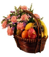 Carnations With A Basket Of Assorted Fruits