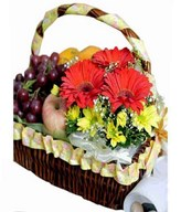 Assorted Fruits With Small Flower Arrangement in a Basket