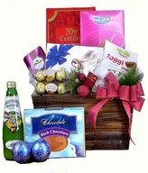 A bottle of sparkling juice with Ferrero Rocher & assorted chocolates in a basket