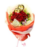 Hand bouquet of red roses and chocolates