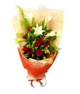 Hand bouquet of red rose and white lilies