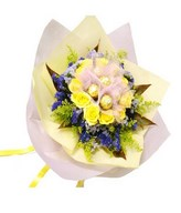 Bouquet of 12 Yellow Roses with 6 Ferrero Rocher at center and fillers