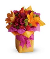 Basket of brightly-colored lilies, purple roses, pink carnations and greeneries