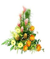 Basket of ginger flowers, yellow orange gerberas, decorated with greeneries