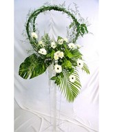 Flower arrangement of white daisies and carnations
