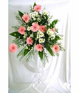 Flower arrangement of Pink Daisies/Gerberas with Small Flowers & Greens