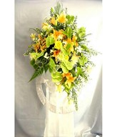 Floral arrangement of lilies and anthuriums