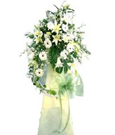 Arrangement of White Lilies and Daisies in Funeral Stand