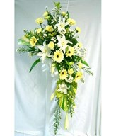 Flower arrangement of lilies and daisies