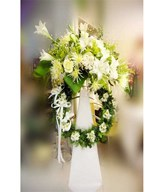 Assorted white flowers on funeral stand