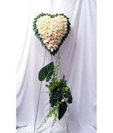 Heart-shaped floral arrangement of pastel roses