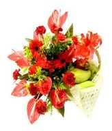 Red flower arrangement & assorted fruits in a basket