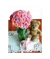 Mixed Roses in a bouquet with Teddy Bear